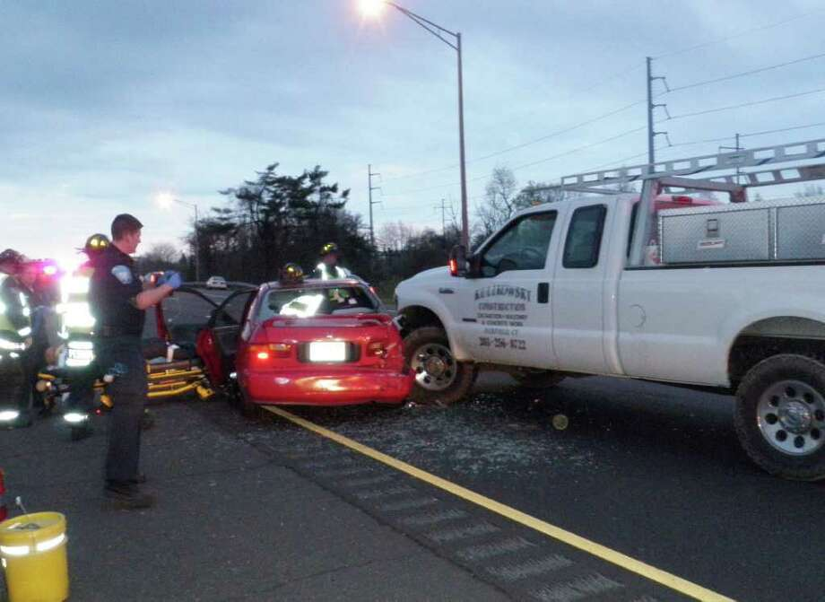 Two men in a sedan were injured Friday night after colliding with a pickup truck Friday night on Interstate 95 in Westport. Photo: Contributed Photo/Westport Fire Department / Westport News contributed