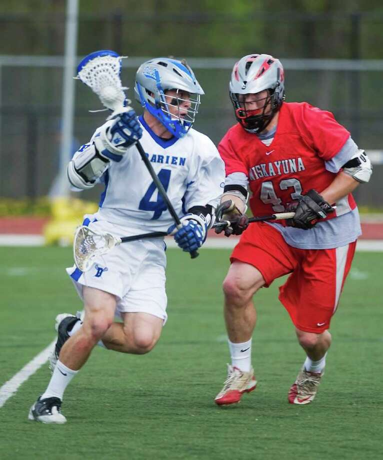 Darien High School's Case Matheis controls the ball against Niskayuna High School's Niki Schuler in boys lacrosse in Darien, Conn. on Saturday April 30, 2011. Photo: Kathleen O'Rourke / Stamford Advocate