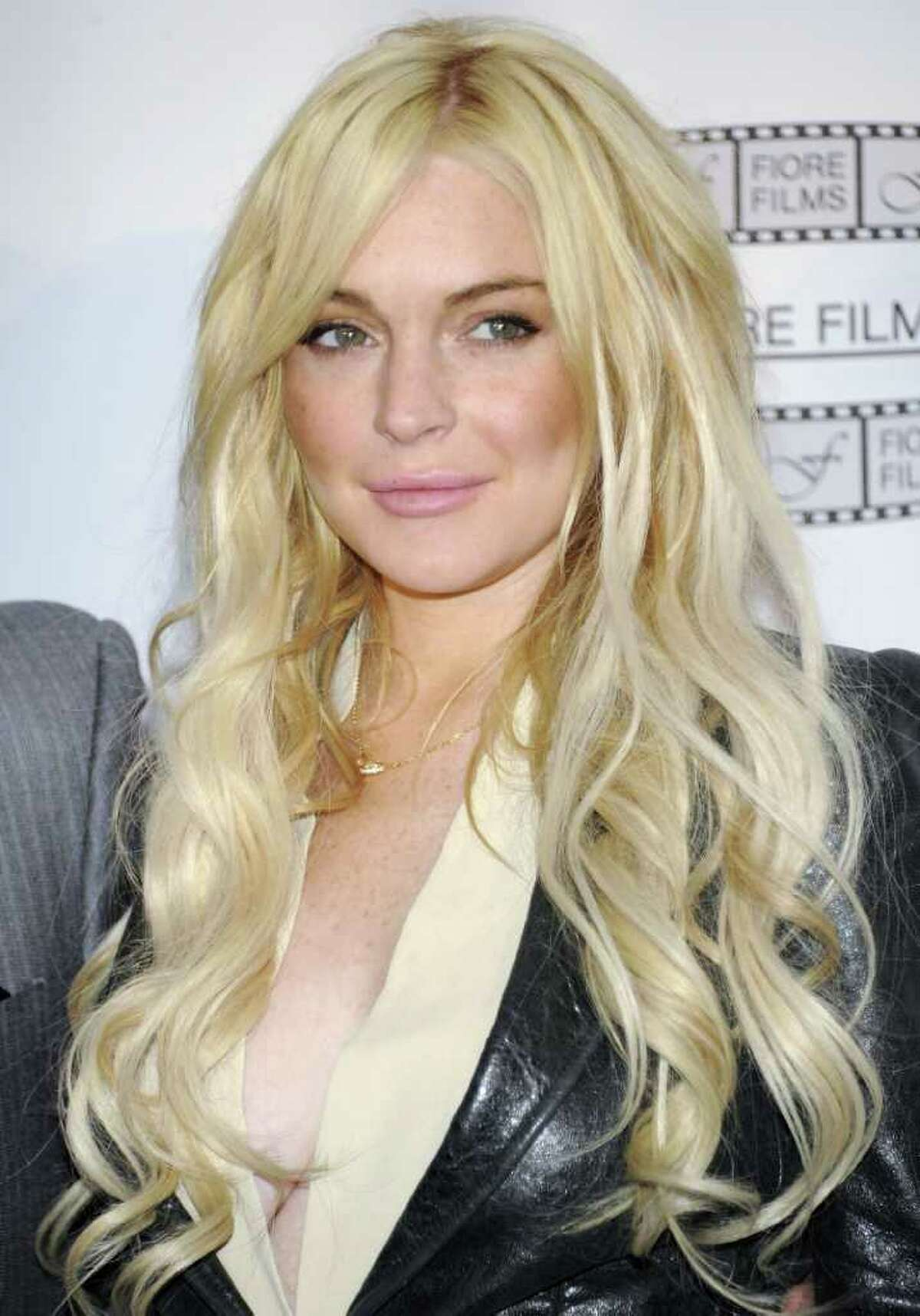 FILE - In this April 12, 2011 file photo, actress Lindsay Lohan poses during a news conference for the film