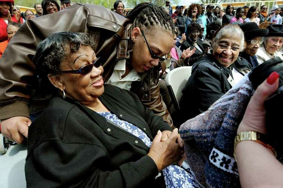 Zola M. Quarterman, daughter of church founder John B. Holmes, left, gets settled in with the help of her granddaughter Tiffani L. West at the ground breaking ceremony on Saturday, April 30, 2011, at Metropolitan New Testament Mission Baptist Church in Albany, N.Y. (Cindy Schultz / Times Union) Photo: Cindy Schultz