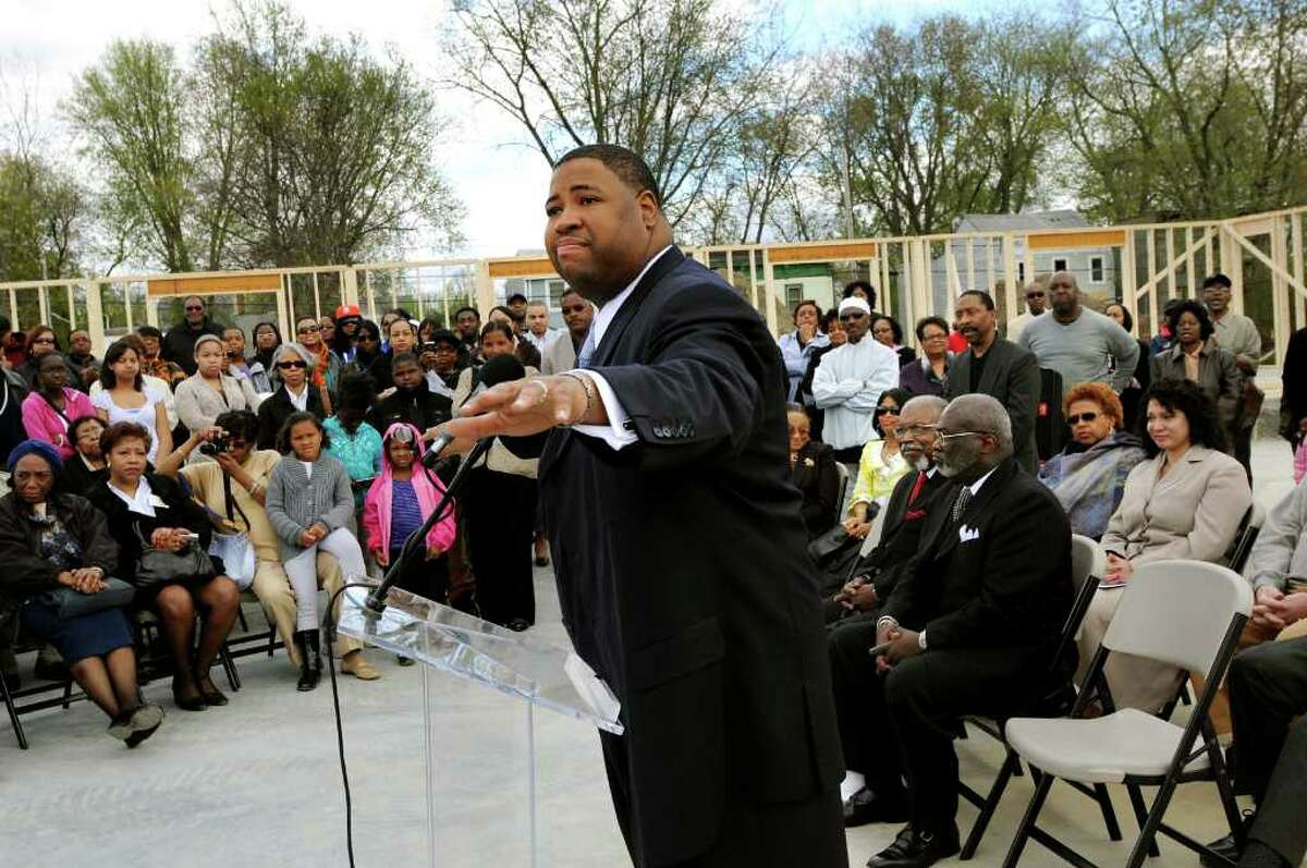Rev. Damone Paul Johnson, center, speaks at the ground breaking ceremony on Saturday, April 30, 2011, at Metropolitan New Testament Mission Baptist Church in Albany, N.Y. (Cindy Schultz / Times Union)