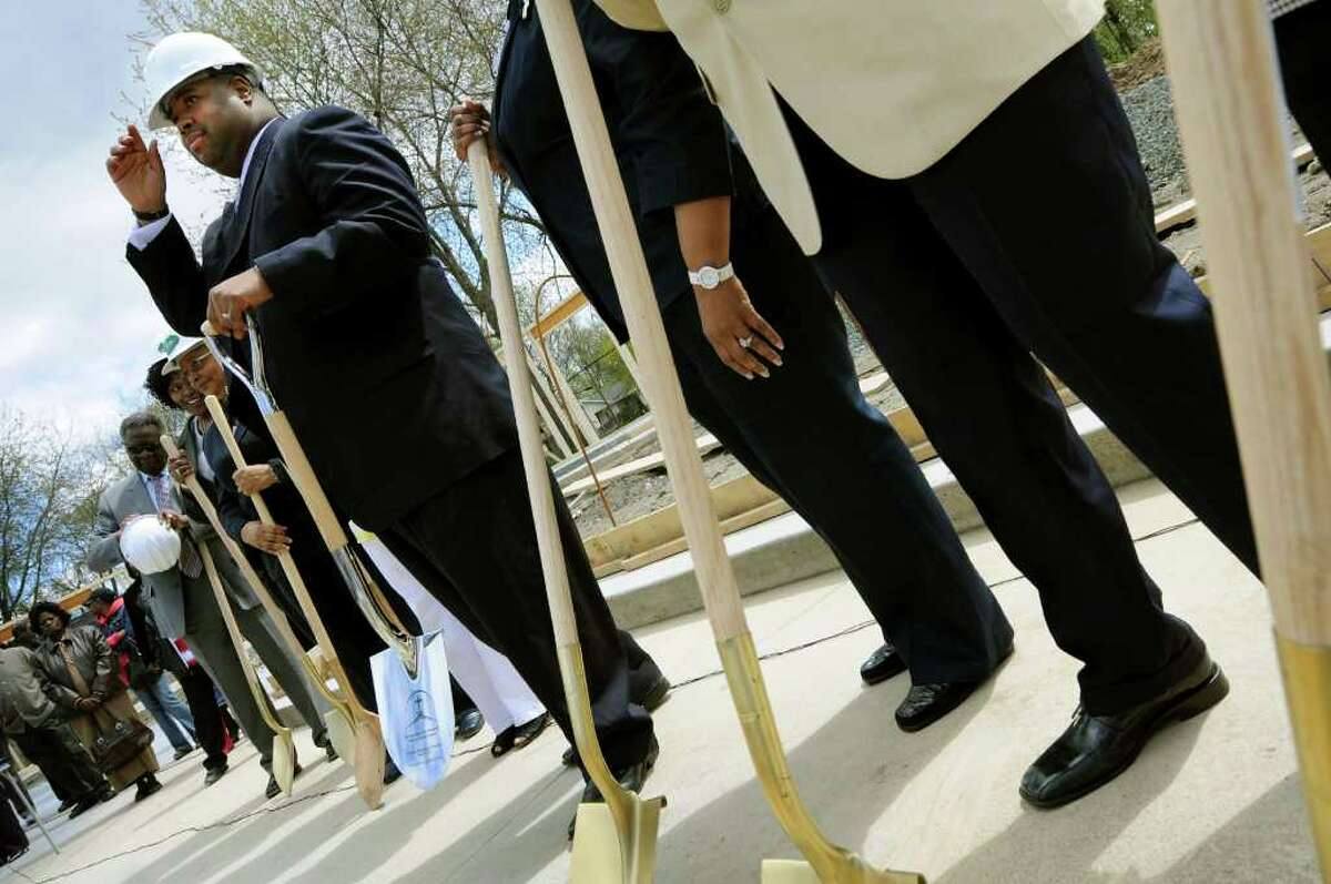 Rev. Damone Paul Johnson, center, prepares to break ground for the church's new addition during a ceremony on Saturday, April 30, 2011, at Metropolitan New Testament Mission Baptist Church in Albany, N.Y. (Cindy Schultz / Times Union)