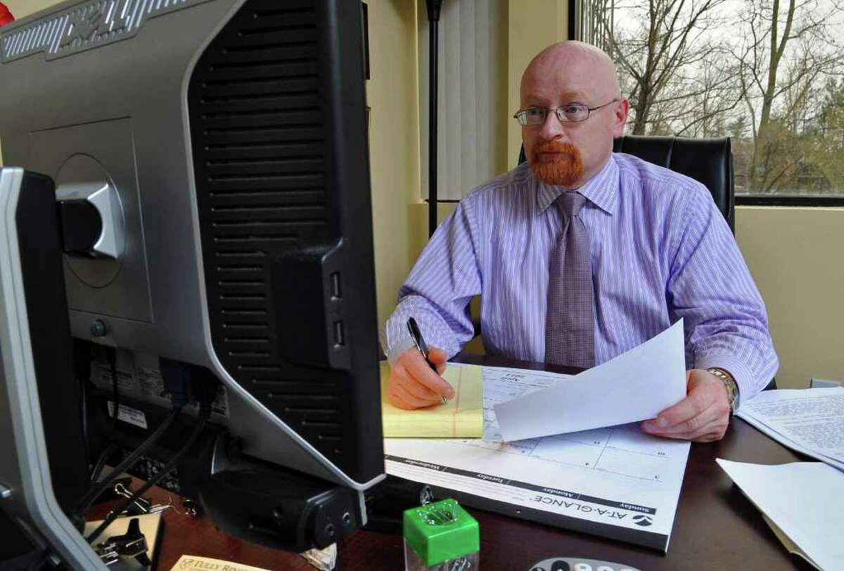 Thomas J. Carr, partner at the Tully Rinckey law firm, works in his office in Colonie, NY. ( Philip Kamrass / Times Union )