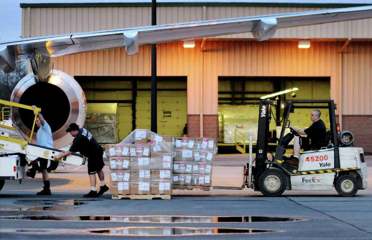 Workers prepare to load small items into a FedEx cargo plane at the Air Cargo Facility on Thursday, April 28, 2011, at the Albany International Airport in Colonie, N.Y. (Cindy Schultz / Times Union)