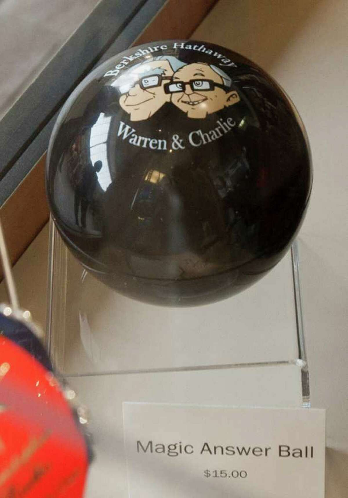 The Berkshire Hathaway Warren & Charlie Magic Answer Ball is offered for sale at a cocktail party hosted by the Berkshire-owned Borsheims jewelry store, in Omaha, Neb., Friday, April 29, 2011. The cocktail party welcomes the many thousands who arrive to Omaha for the annual Berkshire Hathaway shareholders meeting, which starts on Saturday. (AP Photo/Nati Harnik)