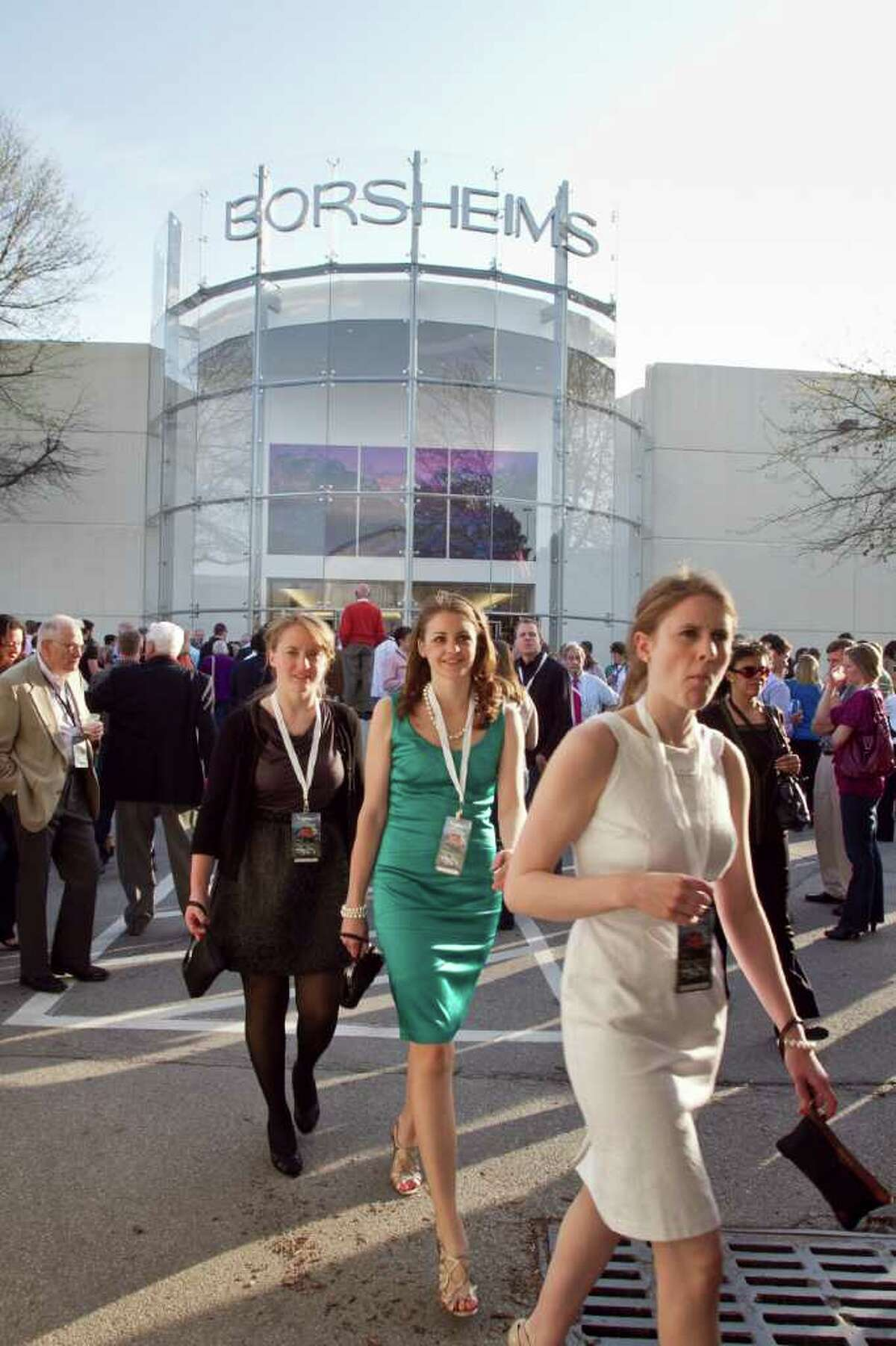 Shareholders walk past the facade of Borsheims, at a cocktail party hosted by the Berkshire-owned jewelry store, in Omaha, Neb., Friday, April 29, 2011. The cocktail party welcomes the many thousands who arrive to Omaha for the annual Berkshire Hathaway shareholders meeting, which starts on Saturday. (AP Photo/Nati Harnik)