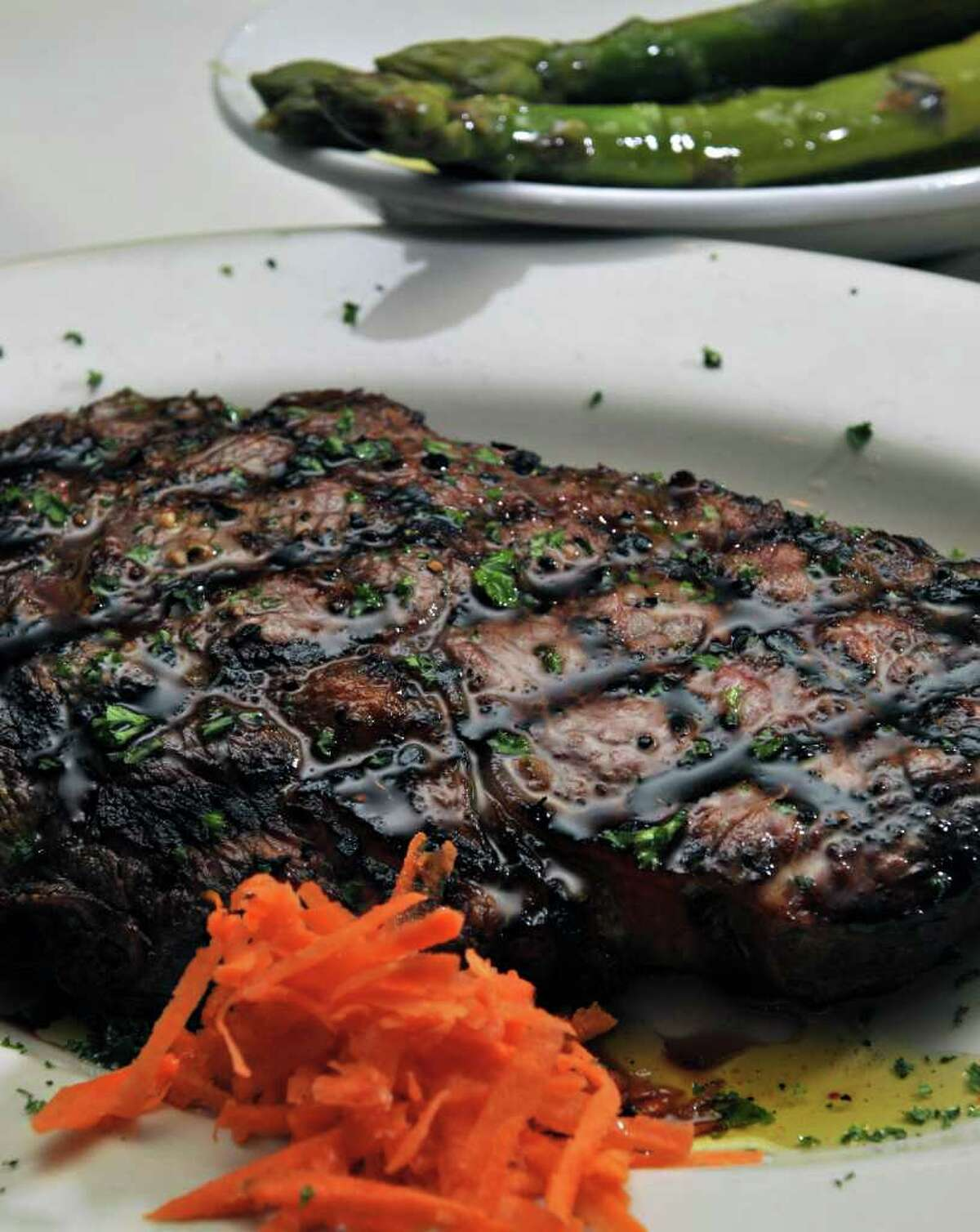 A Delmonico steak with asparagus at Jack's American Bistro in Queensbury Saturday afternoon April 22, 2011. (John Carl D'Annibale / Times Union)