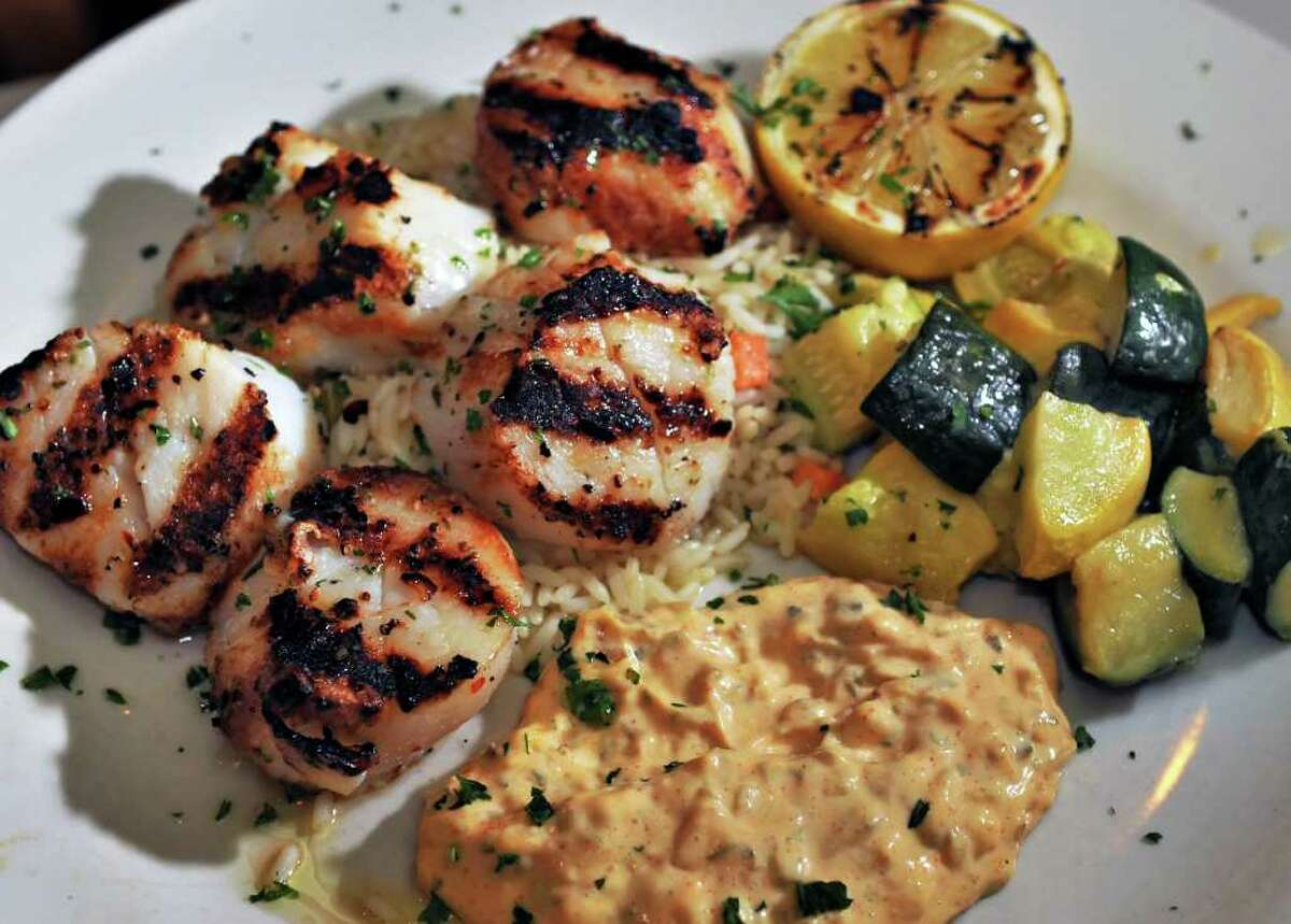 Grilled scallops with remoulade sauce at Jack's American Bistro in Queensbury Saturday afternoon April 22, 2011. (John Carl D'Annibale / Times Union)