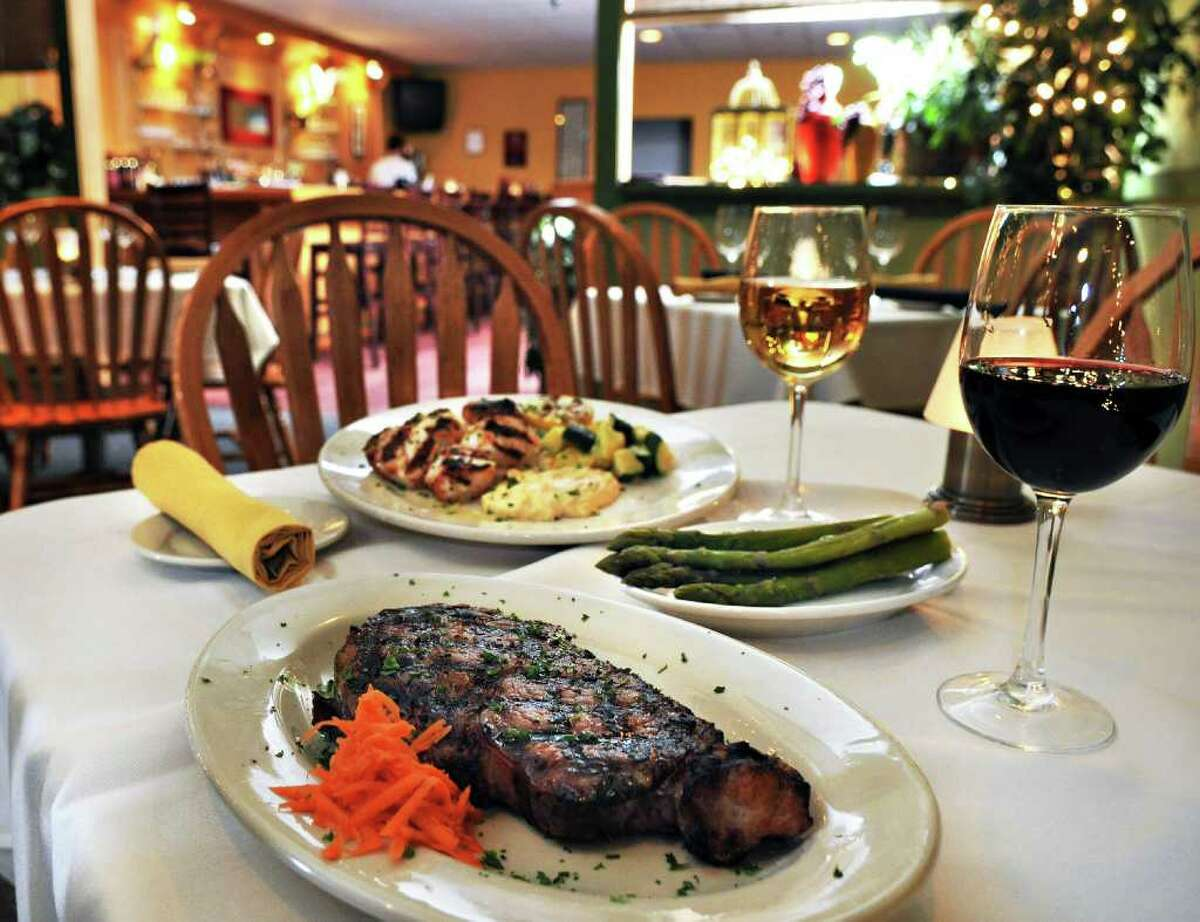 Grilled scallops with remoulade sauce, top, and a Delmonico steak with asparagus at Jack's American Bistro in Queensbury Saturday afternoon April 22, 2011. (John Carl D'Annibale / Times Union)