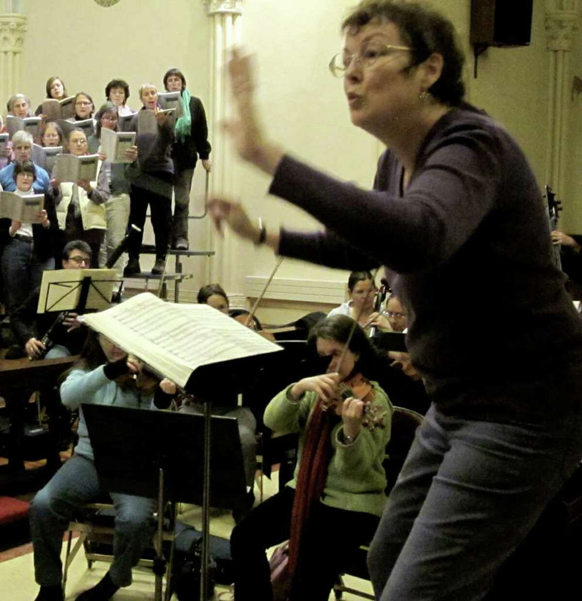 Founding artistic director Janet McGhee rehearses the Battenkill Chorale for
