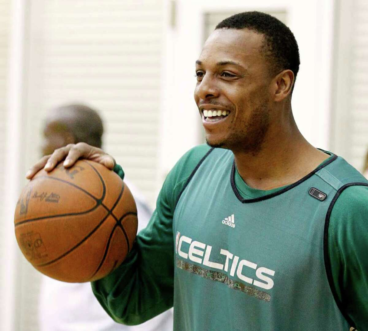 Boston Celtics' Paul Pierce smiles at teammates before practice in Waltham, Mass. Wednesday, April 27, 2011. (AP Photo/Winslow Townson)