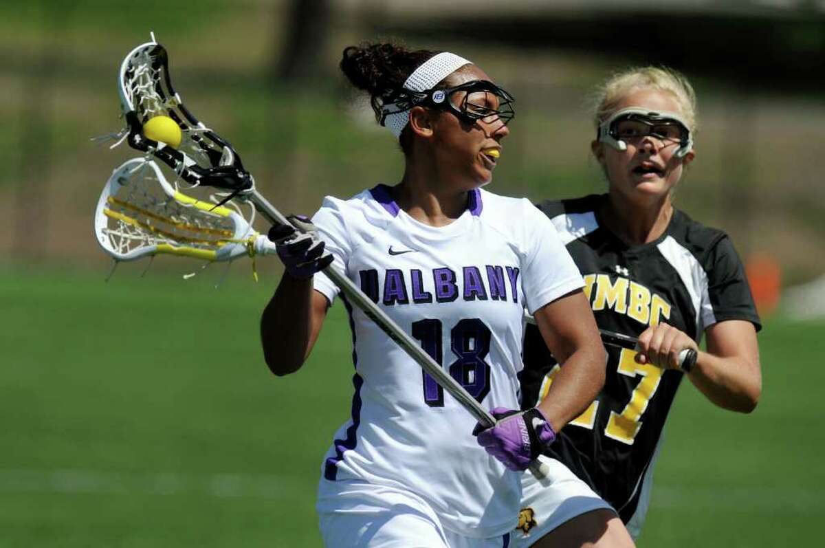 UAlbany's Allie Phelan (18), center, charges the net as UMBC's Jessica Harkey (27) defends during their lacrosse game on Saturday, April 30, 2011, at UAlbany in Albany, N.Y. (Cindy Schultz / Times Union)