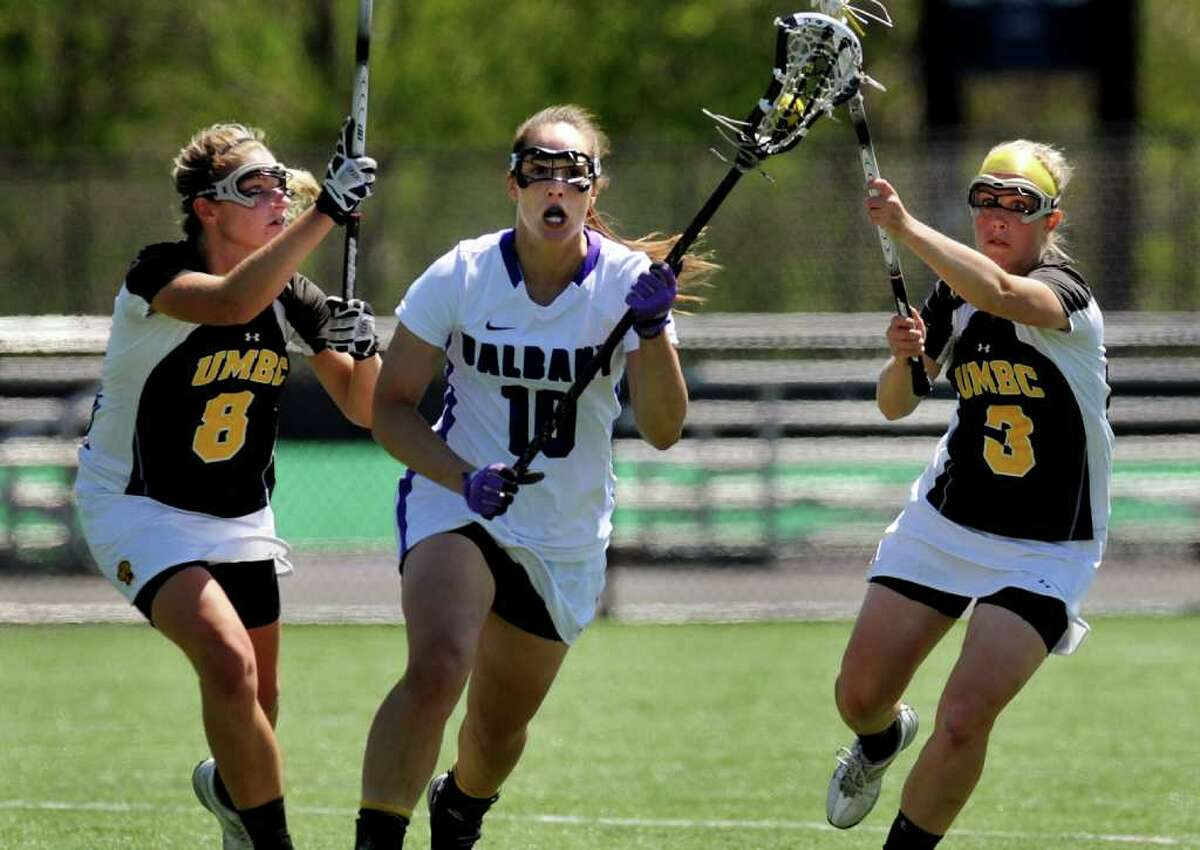 UAlbany's Nikki Branchini (10), center, controls the ball as UMBC's Ashley Stodter (8), left, and Erika Braerman (3) defend during their lacrosse game on Saturday, April 30, 2011, at UAlbany in Albany, N.Y. (Cindy Schultz / Times Union)