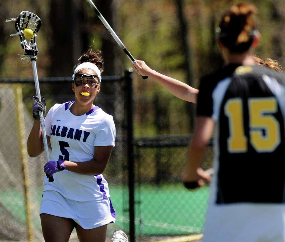 UAlbany's Persy Sample (5), left, controls the ball during their lacrosse game against UMBC on Saturday, April 30, 2011, at UAlbany in Albany, N.Y. (Cindy Schultz / Times Union)