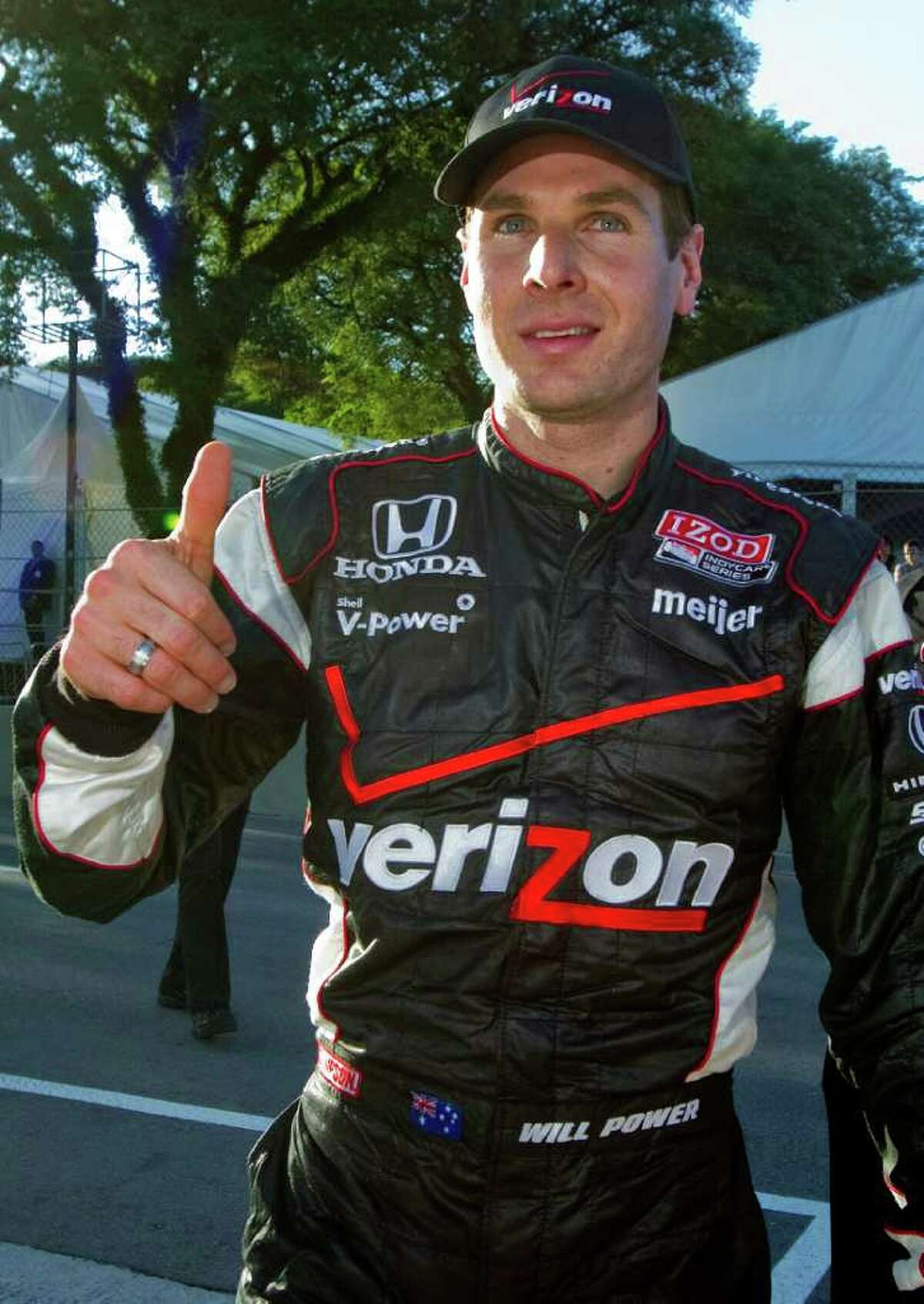 IndyCar driver Will Power, of Australia, gestures to fans after winning the pole position for the Brazilian Grand Prix, in Sao Paulo, Brazil, Saturday, April 30, 2011. Brazil will host the 4th race of the IndyCar season on May 1. (AP Photo/Andre Penner)