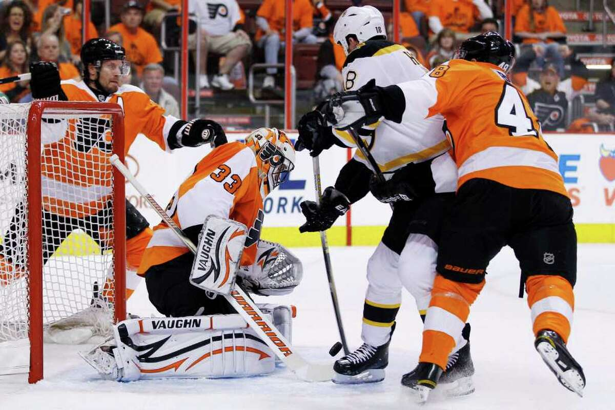 Boston Bruins' Nathan Horton, second from right, scores a goal against Philadelphia Flyers' Brian Boucher, second from left, as Flyers' Kimmo Timonen, left, of Finland, and Danny Briere defend during the first period in Game 1 of the Eastern Conference semifinal NHL Stanley Cup playoffs series, Saturday, April 30, 2011, in Philadelphia. (AP Photo/Matt Slocum)