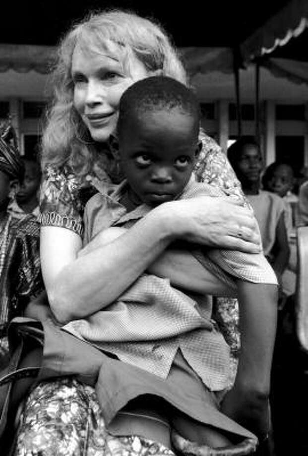 Mia Farrow, a UNICEF goodwill ambassador, holds an injured Nigerian child. Photo: COURTESY PHOTO