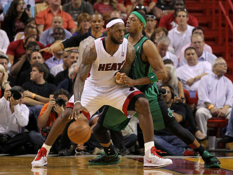 LeBron James, left, and the Boston Celtics will collide in the playoffs again. Photo: Mike Ehrmann, Getty Images