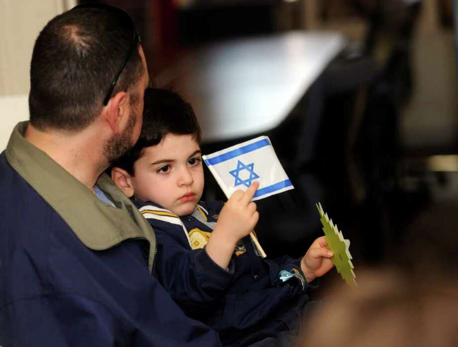 """Linus Abrams with his son Alexander, 4, of Old Greenwich, at the Hebrew Wizards """"virtual Israel"""" to celebrate Israels's 63rd birthday at the Boys & Girls Club of Greenwich on Sunday, May 1, 2011. Photo: Helen Neafsey / Greenwich Time"""