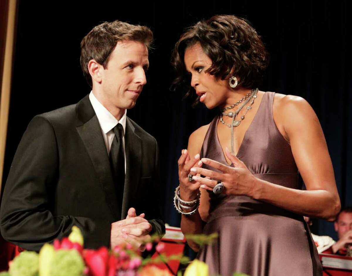 First lady Michelle Obama, talks to Saturday Night Live's Seth Myers at the White House Correspondents?' Association Dinner in Washington, Saturday, April 30, 2011. (AP Photo/Manuel Balce Ceneta)