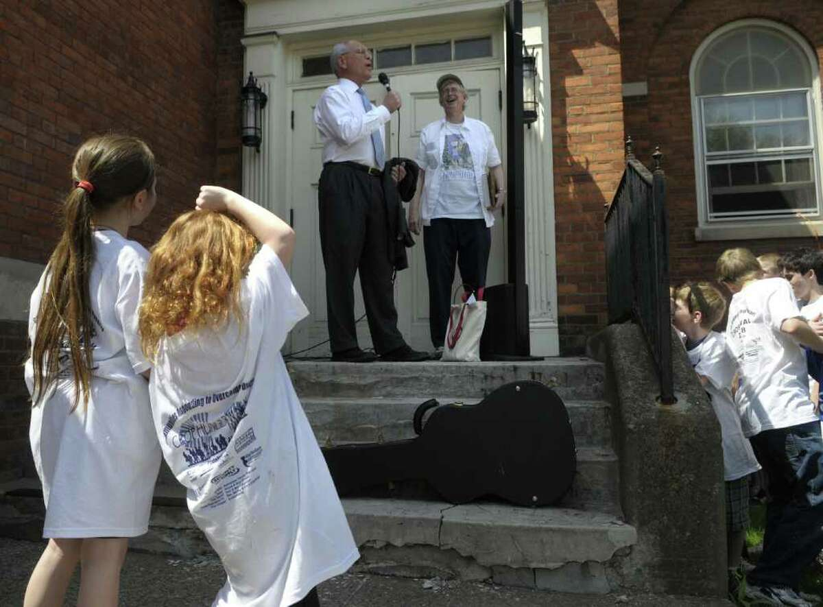 Rep. Paul Tonko, background left, and Rev. Phillip Grigsby, with the Schenectady Inner City Ministry, address those gathered for the Schenectady CROP Walk on May 1. (Paul Buckowski / Times Union)