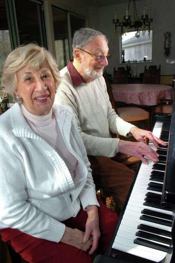 Ted and Jean Simons at the piano in their Westport, Conn. home April 20th, 2011. Photo: Ned Gerard / Connecticut Post