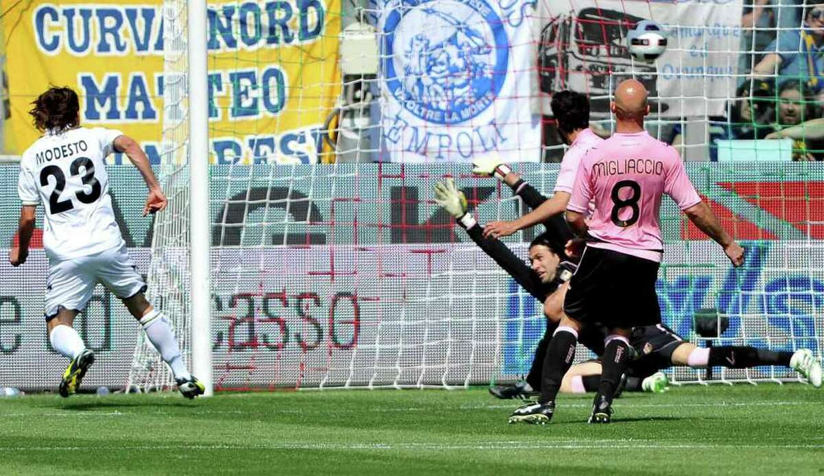 Parma's Francesco Modesto, left, scores as the ball goes into the net top right against Palermo during their Italian Serie A soccer match at Tardini stadium in Parma, Italy, Sunday, May 1, 2011. (AP Photo/Massimo Morelli, Lapresse) ITALY OUT