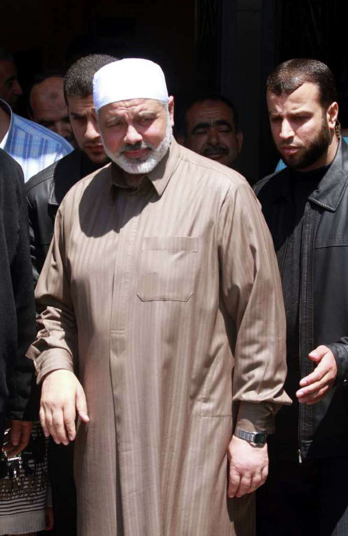 Gaza's Hamas Prime Minister Ismail Haniyeh leaves a mosque after Friday prayers in Gaza City, Friday, April 29, 2011. Officials from the rival Fatah and Hamas movements said Wednesday, they have reached an initial agreement on ending a four-year-old rift that has left them divided between rival governments in the West Bank and Gaza Strip.(AP Photo/Hatem Moussa)