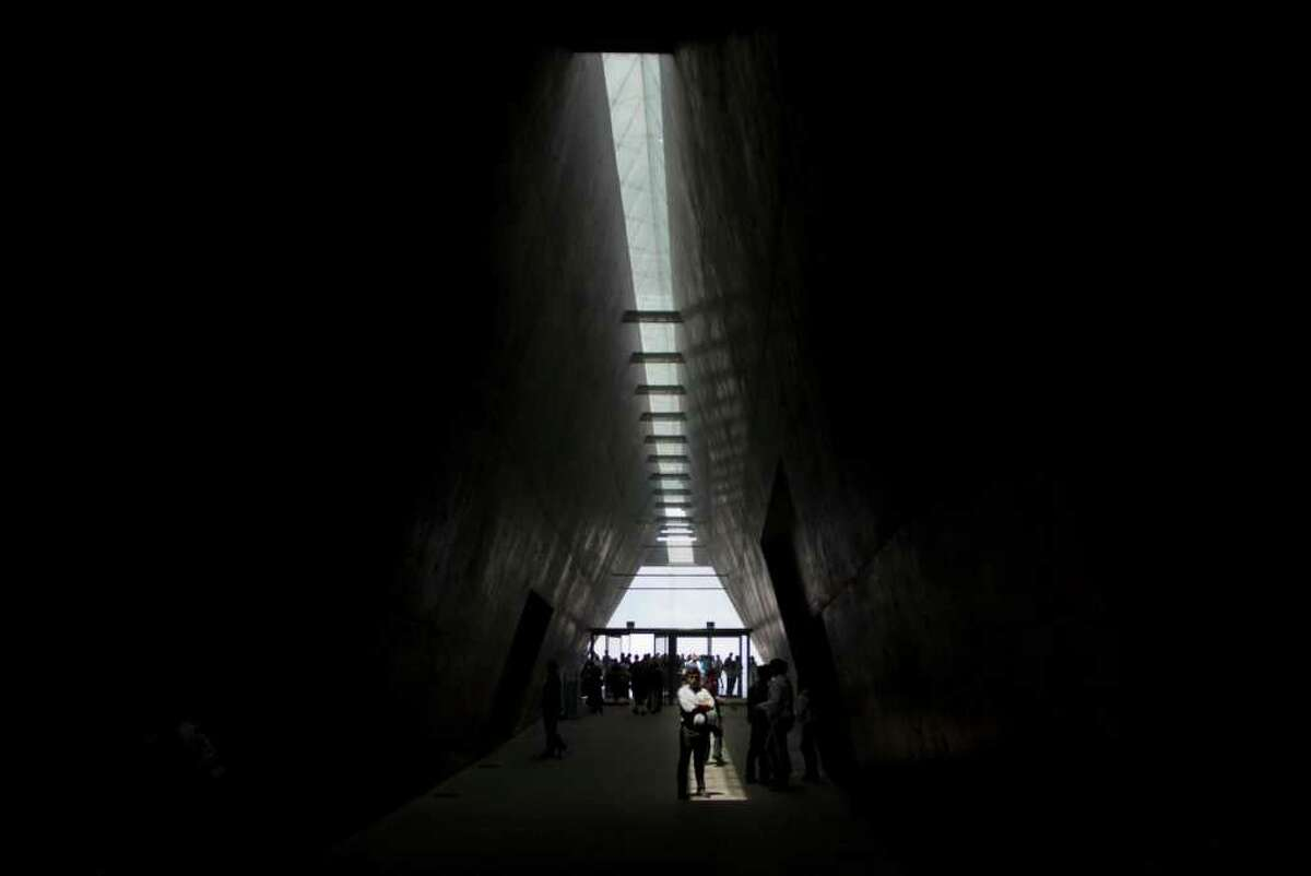 Visitors walk in the corridor of the Yad Vashem Holocaust Memorial in Jerusalem, Sunday, May 1, 2011. Israel will mark its annual Holocaust Memorial Day on Monday, May, 2. (AP Photo/Sebastian Scheiner)