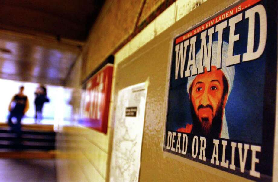A newspaper cover in the form of an Osama bin Laden wanted poster hangs on a wall Sept. 18, 2001 in a Brooklyn, N.Y. subway station. Bin Laden quickly emerged as the leading suspect in the 9/11 terrorist attacks. Photo: Spencer Platt, Getty Images / Getty Images North America