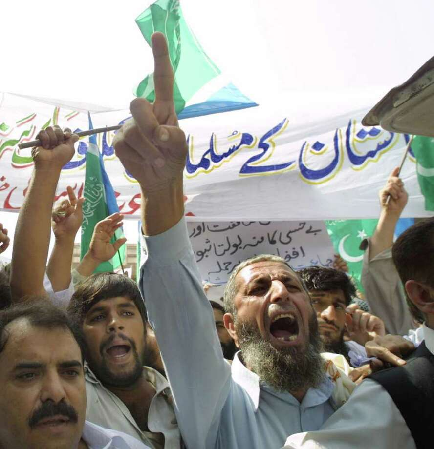 Pro-Bin Laden protesters rally after Friday prayers Sept. 21, 2001 in Peshawar, Pakistan. The protests were non-violent and smaller than previously predicted. Photo: Getty Images / Getty Images North America