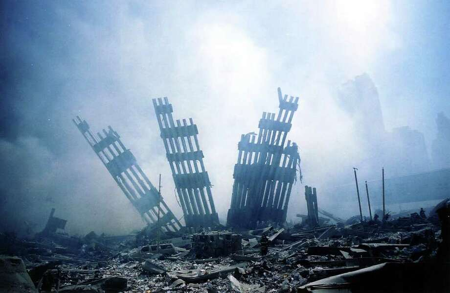The rubble of the World Trade Center smolders following a terrorist attack Sept. 11, 2001 in New York. Photo: AFP, AFP/Getty Images / 2003 AFP