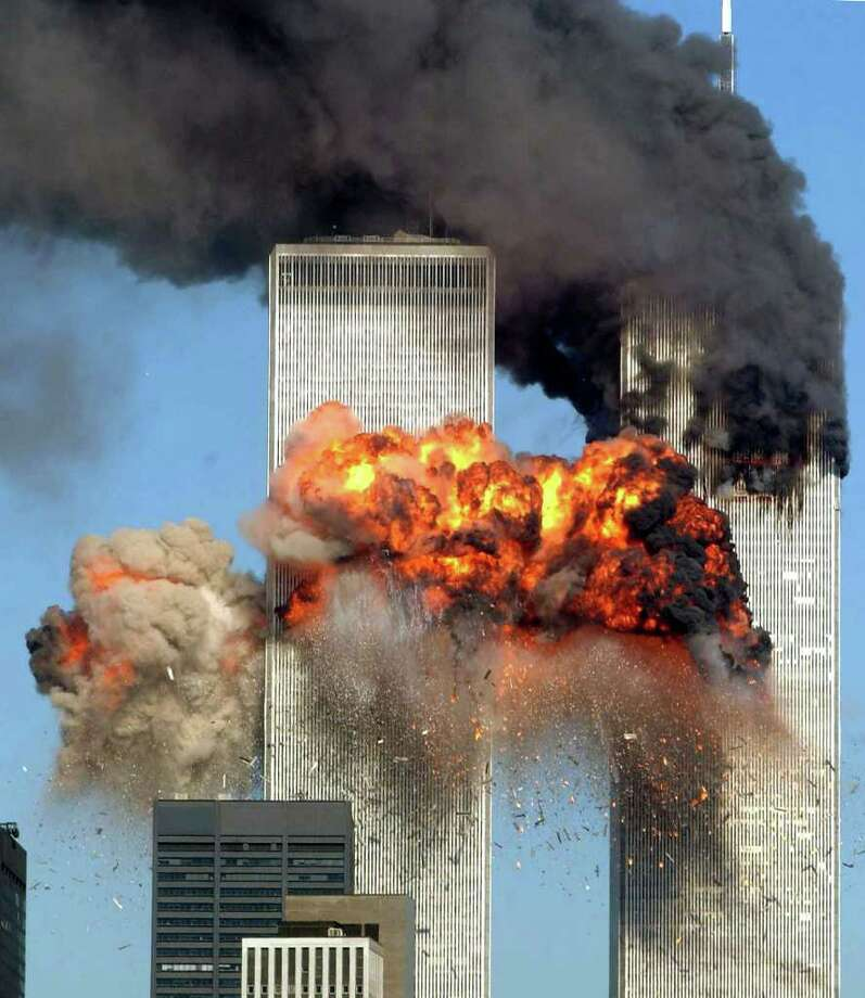A hijacked United Airlines Flight 175 from Boston crashes into the south tower of the World Trade Center and explodes at 9:03 a.m. on Sept. 11, 2001 in New York.  The crash of two airliners hijacked by terrorists loyal to al Qaeda leader Osama bin Laden and subsequent collapse of the twin towers killed some 2,800 people. Photo: Spencer Platt, Getty Images / Getty Images