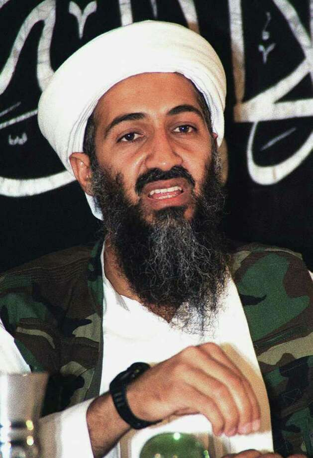 "Undated file picture of Saudi dissident Osama Bin Laden inside Afghanistan. A message posted on an Islamic extremist website and attributed to the al-Qaeda leader in May 7, 2004 offered 22 pounds of gold to whoever kills the top US civilian and military officials in Iraq, UN Secretary General Kofi Annan or his top Iraq official Lakhdar Brahimi. ""We, al-Qaeda, commit ourselves to provide a reward of 10,000 grammes of gold to whoever kills the occupier (Paul) Bremer or his deputy, the commander of US forces or his deputy in Iraq...whoever kills Kofi Annan, the head of the Iraq mission or his envoys, including Lakhdar Brahimi, will get the same reward,"" said the message, posted on a website frequently used by Islamic extremists. The authenticity of the statement could not be independently verified. Ten kilograms of gold was then worth slightly over $120,000. AFP PHOTO/HO/FILES Photo: AFP, AFP/Getty Images / 2004 AFP"