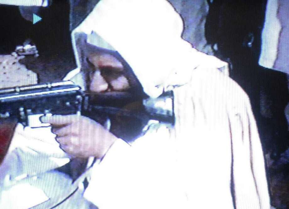 "A video grab dated June 19, 2001 shows Saudi dissident Osama bin Laden firing an AK-47 (Kalashnikov) sub-machine-gun in a video tape said to have been prepared and released by bin Laden himself. Copies of the tape, which shows members of bin Laden's organization Al-Qaeda, or ""The Base"", training at their al-Farouq base in Afghanistan, have been circulated to a limited number of Islamists. AFP PHOTO/Yasser Al-ZAYYAT Photo: -, AFP/Getty Images / AFP"