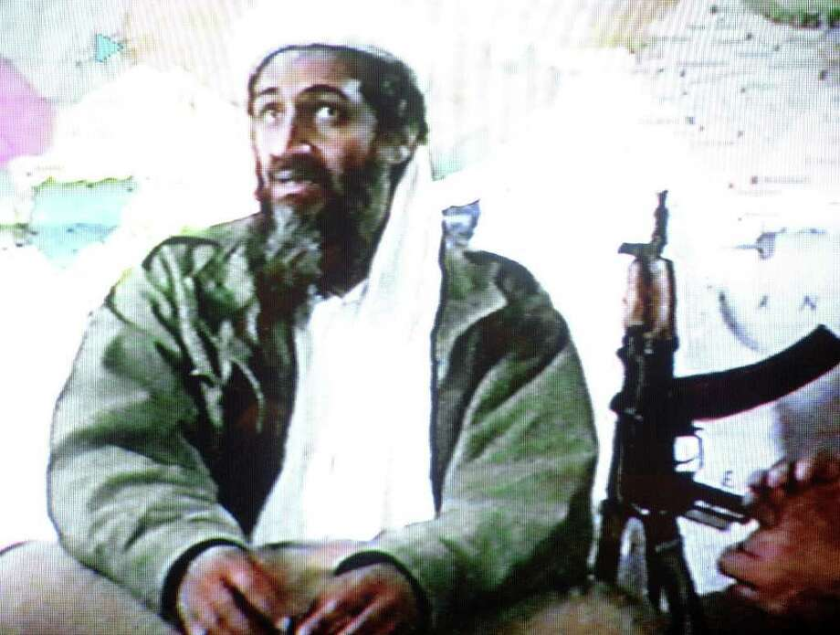 "A video grab dated June 19, 2001 shows Saudi dissident Osama bin Laden in a videotape said to have been prepared and released by bin Laden himself. Copies of the tape, which shows members of bin Laden's organization Al-Qaeda, or ""The Base,"" training at their al-Farouq base in Afghanistan, were circulated to a limited number of Islamists. Photo: -, AFP/Getty Images / AFP"