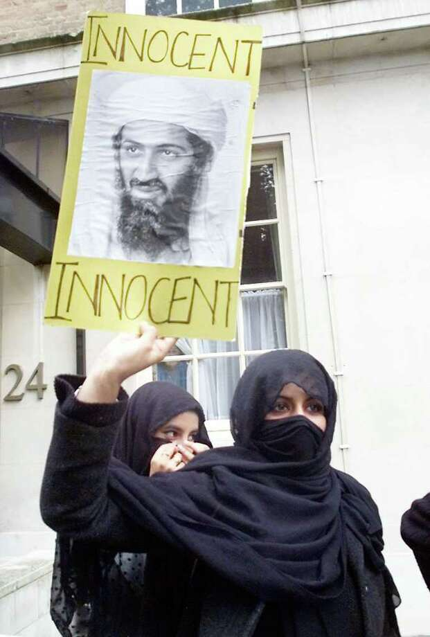 Muslim women demonstrate adjacent to the Pakistan Embassy Sept. 18, 2001, where protesters belonging to the Al- Muhajiroun chanted anti US slogans and their support to Osama Bin Laden and the Taliban.      AFP  PHOTO/GERRY PENNY Photo: GERRY PENNY, AFP/Getty Images / AFP
