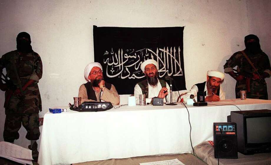 This undated file photo shows Saudi dissident Osama bin Laden (center), with two unidentified associates in an undisclosed place inside Afghanistan. Photo: -, AFP/Getty Images / AFP