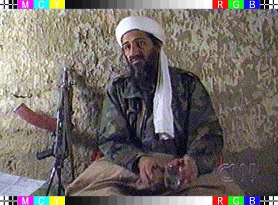 TV grab of Saudi Arabian dissident Osama Bin Laden  aired May 1997 as he answers a journalist's questions in an undisclosed   location in Afghanistan, late March and beginning of April 1997.  More than four years before the 9/11 terrorist attacks for which he was widely blamed, bin Laden was already wanted by the United States and Saudi Arabia on charges of financing international terrorism. Photo: CNN, AFP/Getty Images / AFP