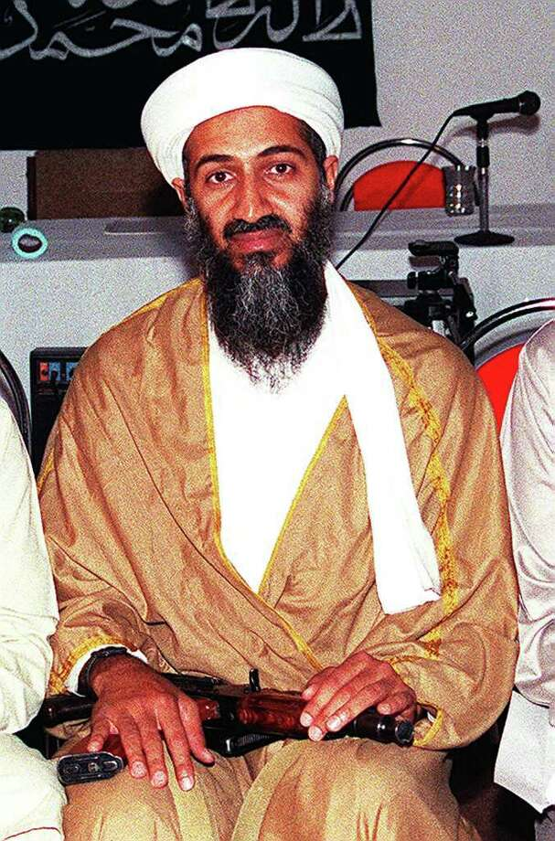 Undated picture of Saudi dissident Osama Bin Laden attending a meeting with a Kalashinkov weapon in his lap in Afghanistan. Photo: AFP, AFP/Getty Images / AFP