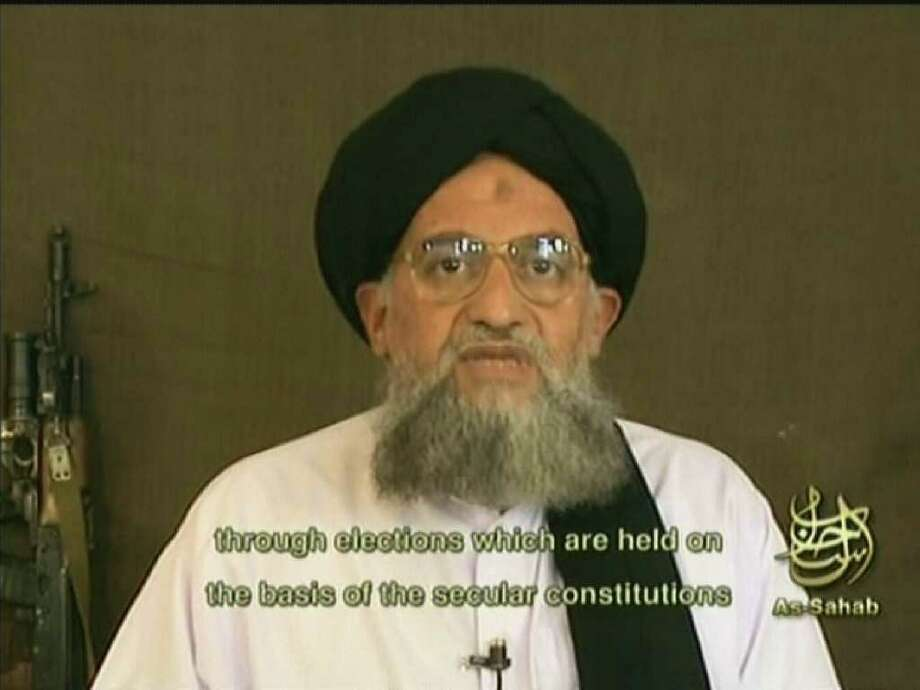 An image grab taken from a video broadcast on Al-Jazeera television Dec. 20, 2006 shows Al-Qaeda number two Ayman al-Zawahiri saying that only jihad, not elections, can bring about the liberation of occupied Palestinian territory. Osama bin Laden's right-hand man slammed Hamas, without naming it, for recognizing Palestinian president Mahmud Abbas and taking part in elections on the basis of a secular constitution. The turbaned Egyptian-born Zawahiri frequently speaks for Al-Qaeda in video or audiotapes, some posted on internet sites, like As-Sahab, and others aired by Qatar-based Al-Jazeera. AFP PHOTO/AL-JAZEERA/AS-SAHAB Photo: AFP, AFP/Getty Images / 2006 AFP