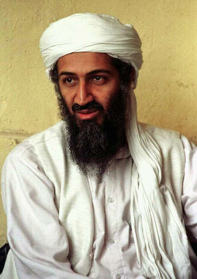 Exiled Saudi dissident Osama bin Laden is seen in this April 1998 photo in Afghanistan. Nine years after the Soviets retreated from Afghanistan, terrorism experts say bin Laden was using his millions to fund attacks against the United States like, perhaps, the Aug. 7, 1998 twin bombings of U.S. embassies in Nairobi, Kenya, and Dar es Salaam, Tanzania, that killed 257 people.   (AP Photo) Photo: Associated Press / AP