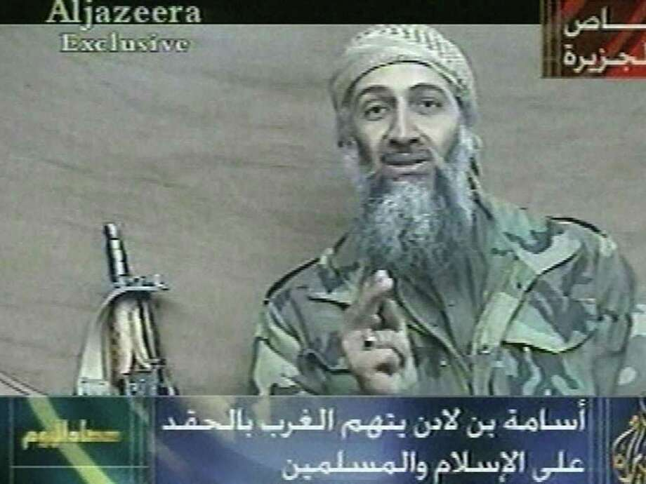"In this image made from video, first broadcast by the Qatar-based television station Al-Jazeera on Wednesday, Dec. 26, 2001, Osama Bin Laden speaks from an undisclosed location at an undisclosed time. His statements indicated he was speaking in recent weeks. Writing at bottom center reads ""Osama bin Laden condemns/accuses the West of hating the religion of Islam and the Muslims."" At top right is ""Exclusive to Al-Jazeera."" At bottom left is the name of the news program ""Events of Today."" (AP Photo/Al-Jazeera)  Photo: Associated Press / AL JAZEERA"