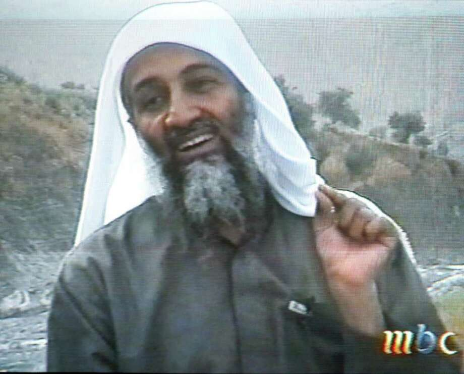 "This frame grab from the Saudi-owned television network MBC (Middle East Broadcasting Center) shows alleged terror mastermind Osama bin Laden gesturing an undated videotape broadcast by the Dubai-based MBC April 17, 2002. Bin Laden hailed the economic losses suffered by the United States as a result of the September 11 suicide attacks on Washington and New York in the tape which was reportedly recorded in December. ""God ordered us to terrorize the infidels, and we terrorized the infidels,"" the spokesman of Bin Laden's al-Qaeda network Suleiman Abu Ghaith said in the same tape, claiming the group's responsibility for the September 11 suicide attacks.  AFP PHOTO/MBC Photo: -, AFP/Getty Images / AFP"