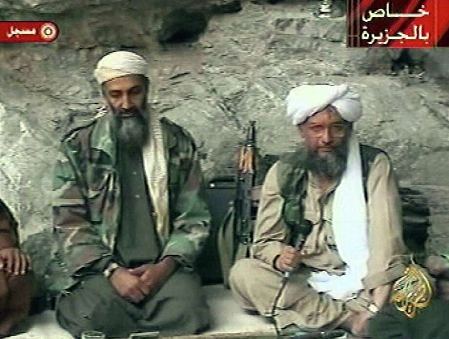 "Osama bin Laden, left, with his top lieutenant Egyptian Ayman al-Zawahri, is seen at an undisclosed location in this television image broadcast Sunday, Oct. 7, 2001. U.S. authorities say they have ""high confidence"" about the authenticity of a new audiotape in which al-Qaida's second-in-command purportedly urges Muslim youths to strike against the United States and its allies, Friday, Oct. 1 2004.  (AP Photo/Al Jazeera) Photo: Associated Press / AL JAZEERA"