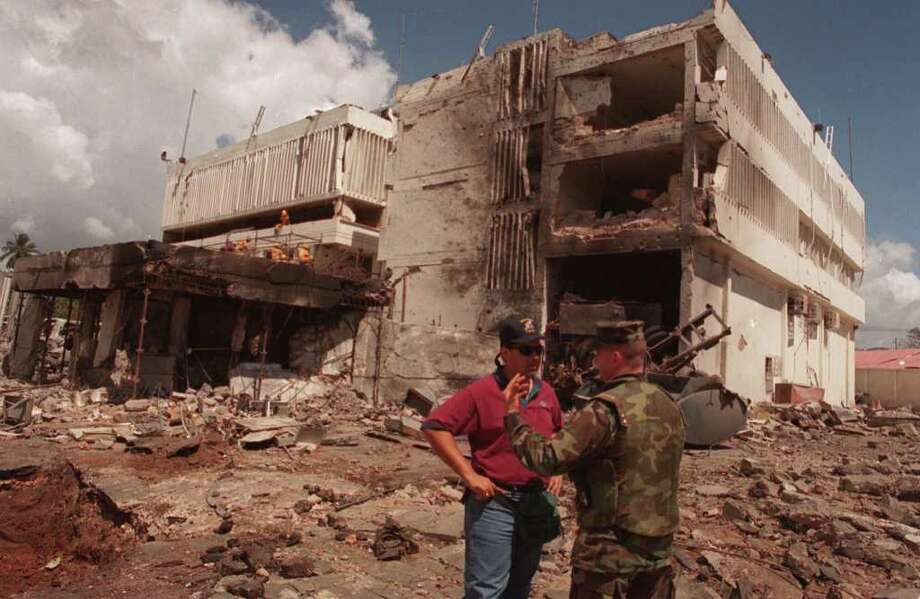 In this Aug. 15, 1998 file photo, a United States Marine talks with an FBI investigator in front of the damaged U.S. Embassy in the capital Dar es Salaam, Tanzania. Osama bin Laden, leader of the al-Qaida organization behind the Sept. 11, 2001 attacks against the United States and blamed for the 1998 embassy bombings in Kenya and Tanzania, is dead, a person familiar with the situation said late Sunday. Photo: AP