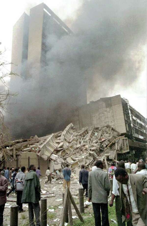 In this Aug. 7, 1998 file photo, onlookers stand at the foot of the damaged buildings in Nairobi, Kenya, after a huge explosion ripped apart a building in the Kenyan capital, heavily destroying the U.S. Embassy. Osama bin Laden, leader of the al-Qaida organization behind the Sept. 11, 2001 attacks against the United States and blamed for the 1998 embassy bombing in Kenya and Tanzania, is dead, a person familiar with the situation said late Sunday. Photo: AP