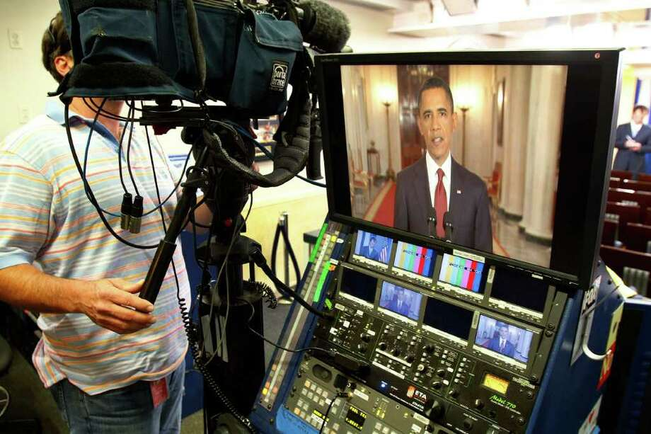 President Barack Obama is seen on a television monitor in the press briefing room as he makes a televised statement on the death of Osama bin Laden from the East Room of the White House in Washington, Sunday, May 1, 2011. Photo: AP