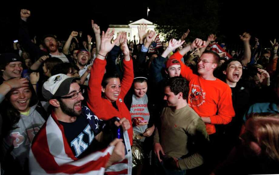 A crowd outside the White House in Washington, cheers Sunday, May 1, 2011, upon hearing the news that terrorist leader Osama bin Laden is dead. Photo: AP