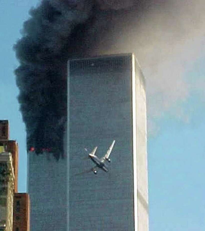 In this Sept. 11, 2001 file photo, a jet airliner is lined up on one of the World Trade Center towers in New York. A person familiar with developments said Sunday, May 1, 2011 that Osama bin Laden is dead and the U.S. has the body. Photo: AP